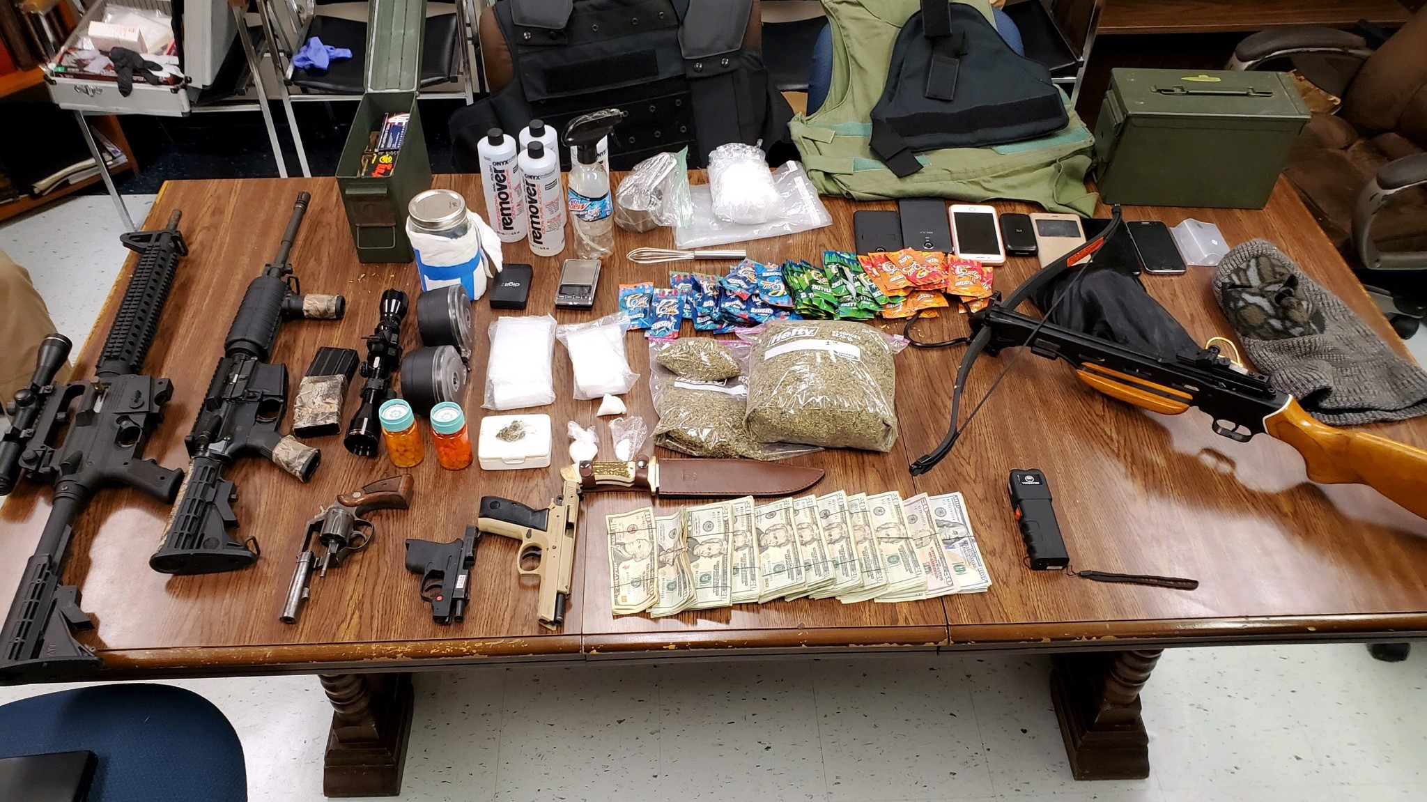 Guns, drugs, and crossbow found in Friday morning drug bust