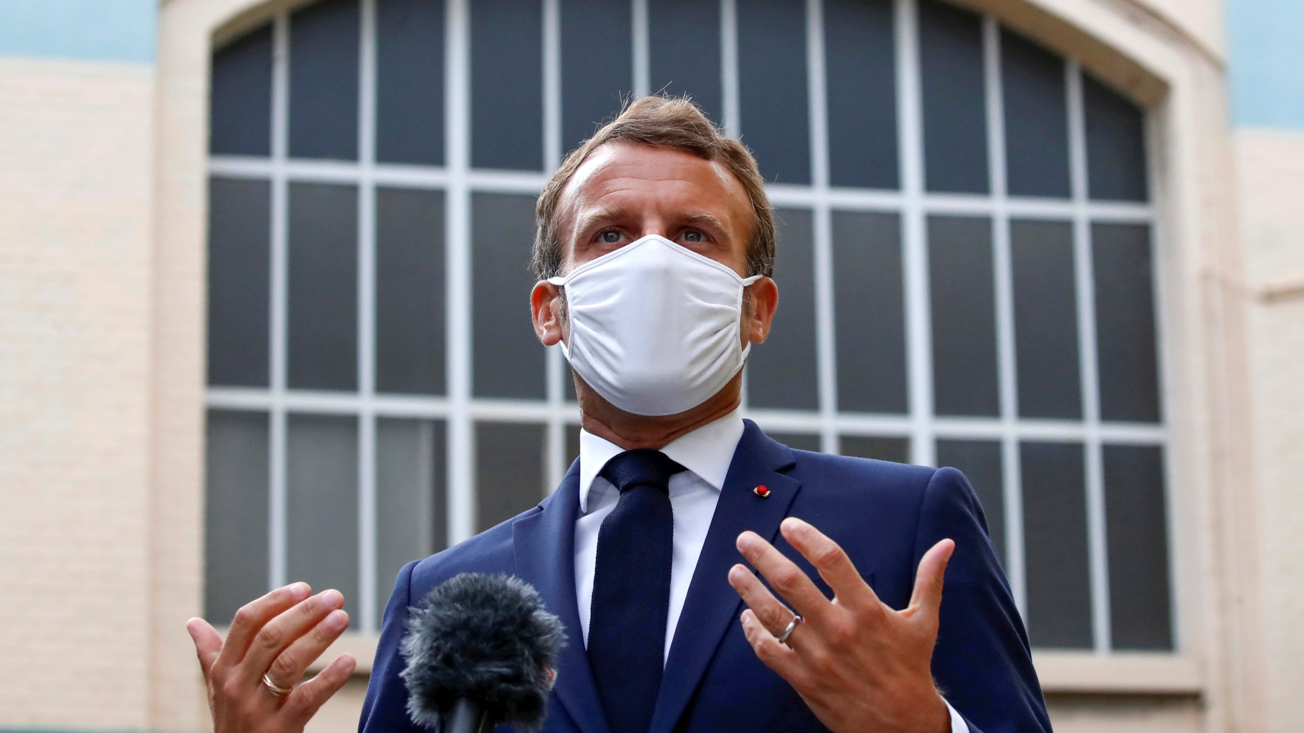 French President Emmanuel Macron visits a site of pharmaceutical group Seqens